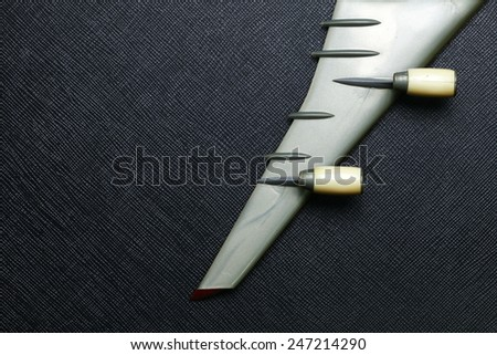 Old plastic airplane model focus at wing and turbine engine part put on the black color leather surface background represent the airplane part. - stock photo