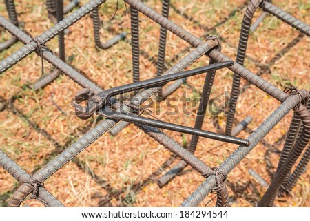 Old pliers and iron rod structure - stock photo