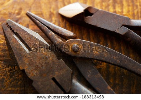 Old pliers, needle nose pliers, clippers. - stock photo