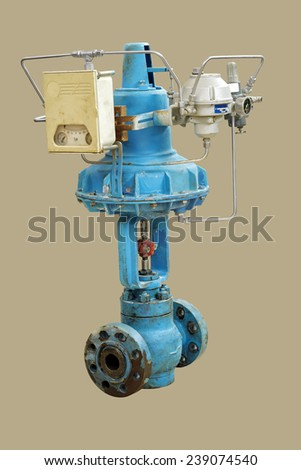Old pneumatic valve. Close-up isolated on a beige background. - stock photo