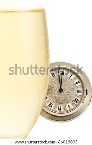 old pocket watch behind a cold glass with champagne isolated on white background