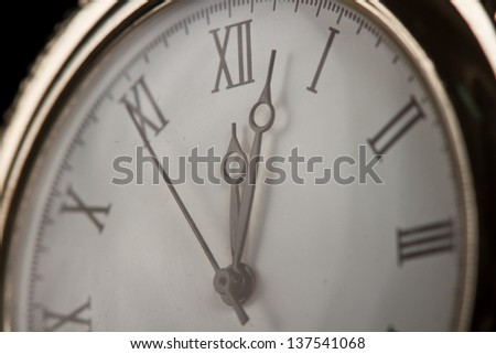 Old pocket watch close-up macro faded detail dial - stock photo