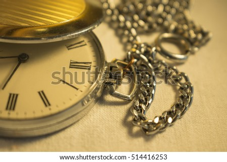 Old pocket watch in close-up view