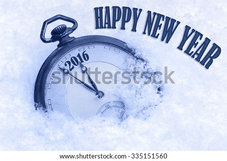 Old pocket watch in snow, Happy New Year 2016 greeting card in English language - stock photo