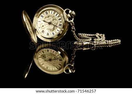 old pocket watch on black background with reflection - stock photo