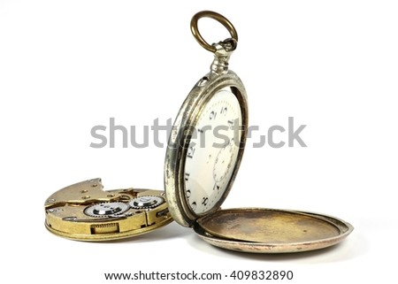 old pocket watch under repair isolated on white background - stock photo