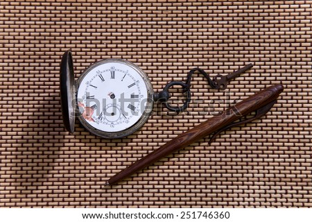 old pocket watch with key  and pen  - stock photo