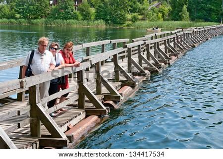 Old pontoon bridge on Lake Galve in Trakai, Lithuania - stock photo