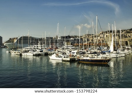 Old Port in Genoa on the background. - stock photo