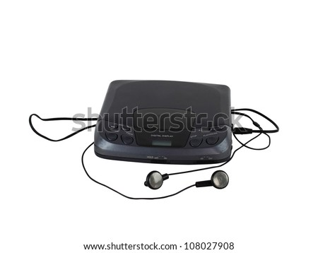 Old portable CD audio player with headphones - stock photo