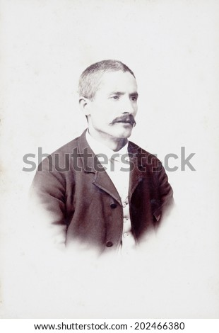 Old Portrait of a man. Made in a studio. Vintage. - stock photo