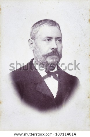 Old Portrait of a man. Made ??in a studio. Vintage. Year 1890 - stock photo