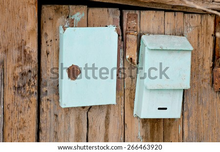 Old post boxes on the wooden wall of slum house in Astrakhan, Russia. - stock photo