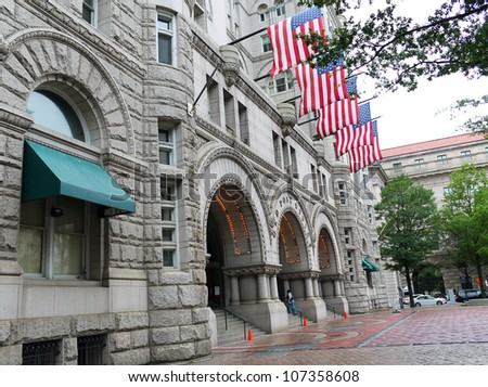 Old Post Office building with American Flags, Washington, DC, United States of America - stock photo