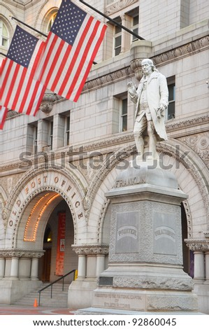 Old Post Office building with Benjamin Franklin Statue foreground, Washington DC United States - stock photo