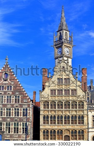 Old Post Office clock tower behind tall Gothic buildings, Ghent, Belgium