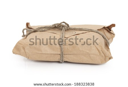 Old post parcel  tied with a string, isolated on white background  - stock photo