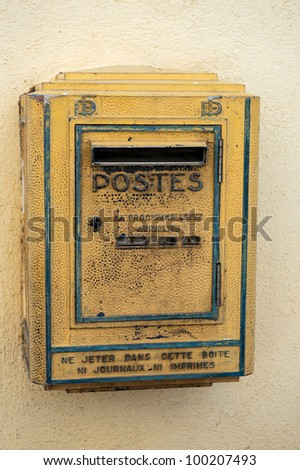 Old Postbox hanging at the wall in France