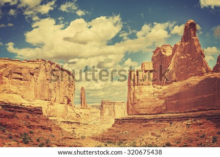 Old postcard from Wild West, retro toned photo of Arches National Park, Utah, USA. - stock photo