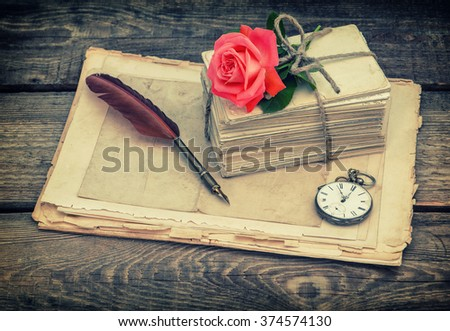 Old postcards and letters with red rose flower. Retro style toned picture - stock photo