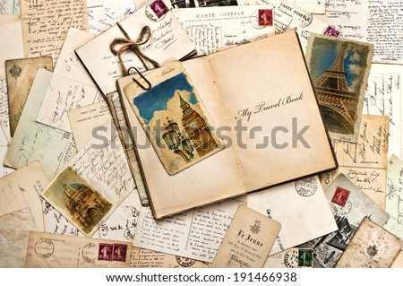 old postcards, letters, mails and open journal with sample text My Travel Book. vintage style travel background - stock photo