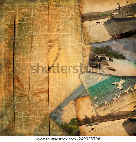 Old postcards on wooden planks with scratches. Background for design album. Postcards it is not in the public domain.This vintage pastiche of my photos