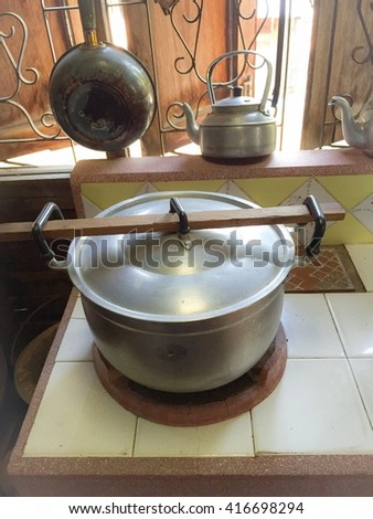Old pot for rice cooking - stock photo