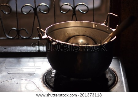Old pot with dramatic lighting