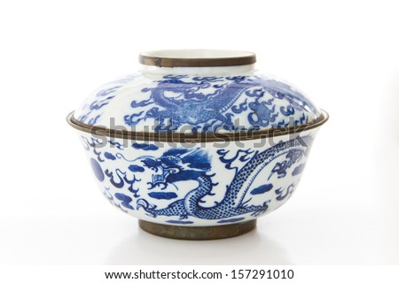 Old pottery porcelain on white background - stock photo