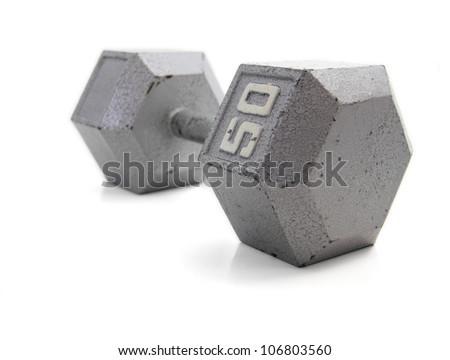 Old, 50 pound exercise dumbbell hand weight. - stock photo