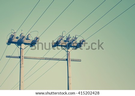old power line against sky background, retro style photography - stock photo