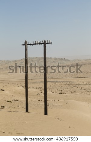 old power pole in the desert near Kolmanskop, Namibia - stock photo