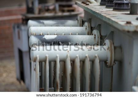 Old power transformer - stock photo