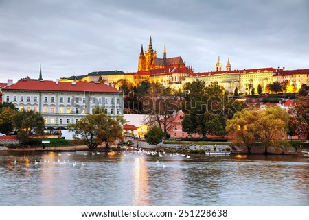 Old Prague cityscape in the evening at sunset - stock photo