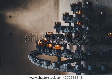 old prayer candle holder. Selective focus  - stock photo