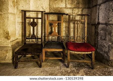 Old prayer chairs - stock photo