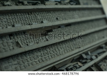 Old Printing Press Letter Blocks In A Wooden Shelf