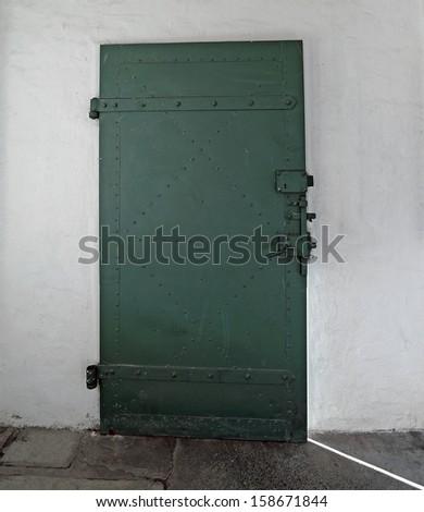 Old prison door - stock photo
