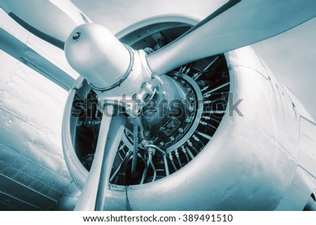 Old propeller aircraft, detailed look at the engine. Technical blue tinted - stock photo