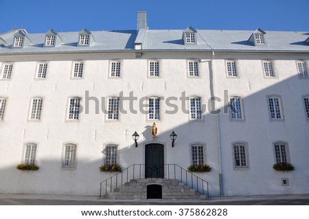 Old Quebec Seminary (French: Seminaire de Quebec), Quebec City, Quebec, Canada. Seminaire de Quebec is built by Francois Laval in 1663. Old Quebec City is a UNESCO World Heritage Site.  - stock photo