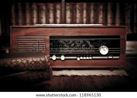 Old radio in a room with books - stock photo
