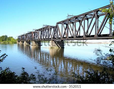 Old rail bridge - stock photo