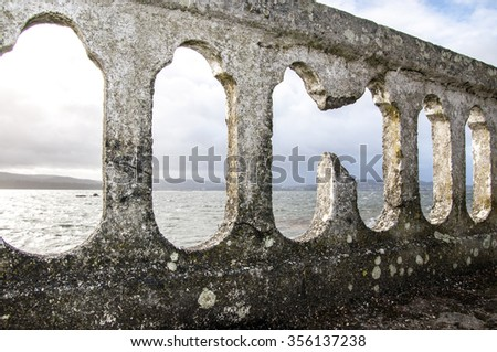 Old railings in the sea - stock photo