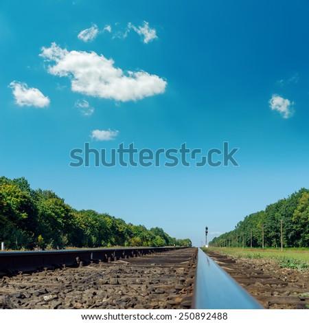 old railroad closeup under deep blue sky - stock photo