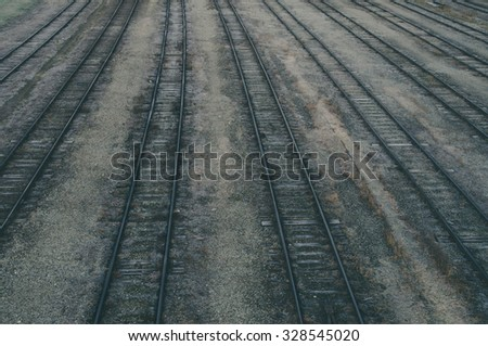 Old railroad tracks at train station, transportation infrastructure - stock photo