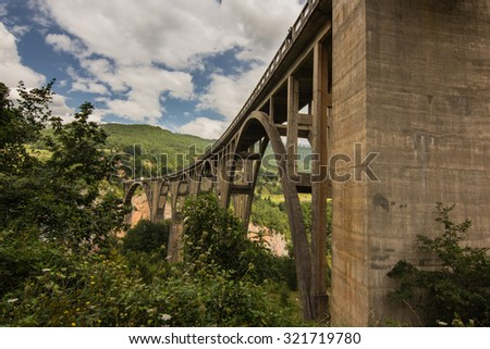 old railway bridge in world's second largest canyon of Tara river in Montenegro - stock photo