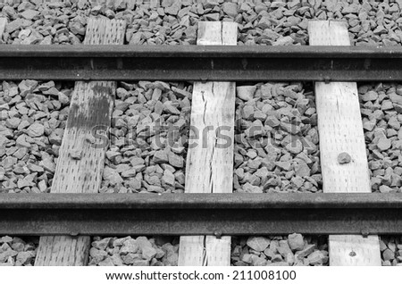 old railway on gravel blue stone black and white version - stock photo