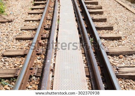 old railway tracks that has not yet come secondary tracks. - stock photo