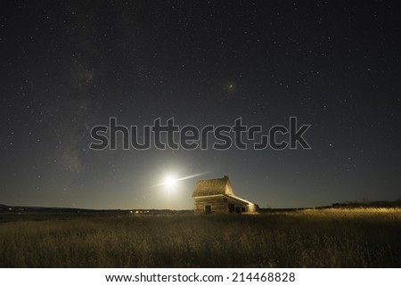 Old Ranch House in Belle Fourche, South Dakota with Night Sky Filled with Stars. - stock photo
