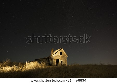 Old Ranch House in Belle Fourche, South Dakota with Night Sky Filled with Stars.